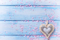Background  with  decorative heart  and pink petals on blue wood Royalty Free Stock Photo