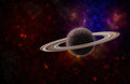 Background of a deep space star field and planet with rings Royalty Free Stock Photo