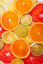 Background of different colored slices of citrus fruits close up Royalty Free Stock Images