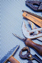 Background with diy tools various and instruments photographed from above over a perforated metal Stock Image