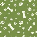 Background with dog paw print and bone on green Royalty Free Stock Photo