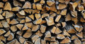 Background of dry chopped firewood logs in a pile Royalty Free Stock Photo