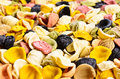 Background of dry pasta orecchiette assorted colors Stock Images