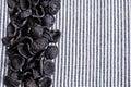 Background of dry pasta orecchiette black striped fabric Stock Images