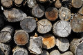 Background of firewood stacked in the woodpile Royalty Free Stock Photo