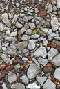 Background with fragments of brick and concrete construction trash on the road closeup texture Royalty Free Stock Image
