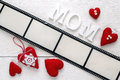 Background with a frame in the form of a film, hearts and mother Royalty Free Stock Photo