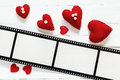 Background with a frame in the form of a film, and red hearts. S Royalty Free Stock Photo