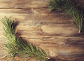 Background frame with pine tree branch on old wooden background board
