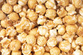 A background of fresh toffee coated popcorn Royalty Free Stock Photo