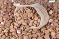 Background of ginger nuts and a jute bag Royalty Free Stock Photo