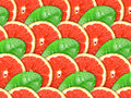 Background of grapefruit slices and green leaf Royalty Free Stock Images