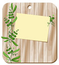 Background with green peas on a cutting board wooden is sheet for recording and pea plants Stock Image