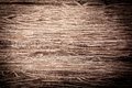Background of heavily textured old wood with a distinct weathered rough woodgrain pattern and a corner vignette Stock Photo