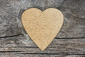 Background with a hole in the shape of heart and old wood board Stock Photos