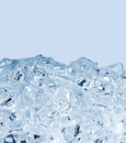 Background with ice cubes in blue light Royalty Free Stock Photo