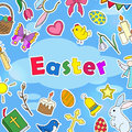 The background Illustration on the Easter theme, simple colored stickers icons on a blue background and the words `Easter`