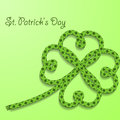 Background with inscription St. Patricks Day. Clover with four petals of green folded rope. Royalty Free Stock Photo
