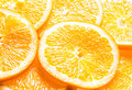 Background of juicy orange slices full frame showing the texture the pulp pith and rind with an angled perspective Royalty Free Stock Photography