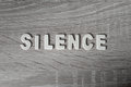 Background. Letters on wooden table. `Silence`. Royalty Free Stock Photo