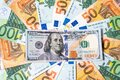 Background made of euro banknotes and dollar banknote Royalty Free Stock Photo
