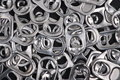Background made metal ring pulls soda drink cans as concept recycling consumerism Stock Photography