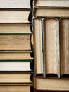 Background made of old books arranged in stacks concept well ordered close Royalty Free Stock Photo