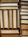 Background made of old books arranged in stacks concept well ordered close Stock Images