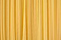 Background made of raw pasta stacked vertically noodles Royalty Free Stock Photos