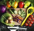 Background menu vegetariants various summer vegetables on a wooden board with peppers, cherry tomatoes, onions, cabbage, cucumbers Royalty Free Stock Photo