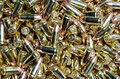 Background of 9mm bullets jumbled together Royalty Free Stock Photo