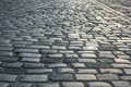 Background of old road paved with granite stones Royalty Free Stock Photo