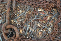 Background of old rusty bent nails, bolts, nuts, screws, chain Royalty Free Stock Photo