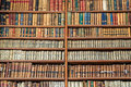 Background of old vintage books on wood bookshelf in a library Royalty Free Stock Photo