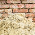 Background of old vintage brick wall with concrete,Weathered texture of racked concrete vintage brick wall background Royalty Free Stock Photo