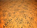 A background of orange vintage style tickets. For movie, concert, plays, and carnivals Royalty Free Stock Photo