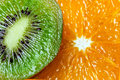 Background parts of orange and kiwi by rings. Royalty Free Stock Photo
