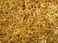 Background of a pile of gold pins. French safety pin Royalty Free Stock Photo