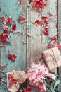 Background with pink peony, peonies petals, gift box and a woode