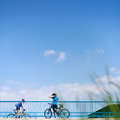 Background for poster or advertisment pertaining to cycling sport outdoor activities female cyclist during a halt on a bridge Royalty Free Stock Image