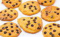 Background pumpkin cookies chocolate white Royalty Free Stock Photos