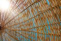 Background rattan parasol of wicker Stock Image