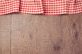 Background with red checked tablecloth and wooden board. View from above Royalty Free Stock Photo
