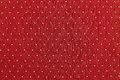 Background of red color fabric with round specks the abstract textured and light are located in ranks on a surface on all area Stock Images