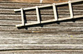 Background retro log house wall wooden ladder hang Royalty Free Stock Photo