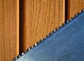 Background with sawblades abstract on wood ocher color Stock Images