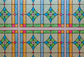 A background of a stained glass window pattern with a variety of colors and shapes Stock Photography