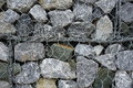 Background of stone and grating wall Royalty Free Stock Photo