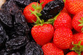 Background from strawberry and prune Royalty Free Stock Image