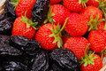 Background from strawberry and prune Royalty Free Stock Images
